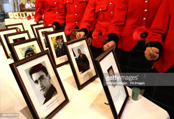 School children from the Queen Victoria School lay poppies beside photographs of soldiers killed in action including Corporal Mark Williams Wright GC...
