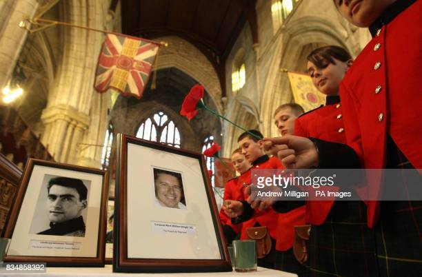 School children from the Queen Victoria School lay poppies beside photographs of soldiers killed in action including Lieutenant Alexander Tweedie and...