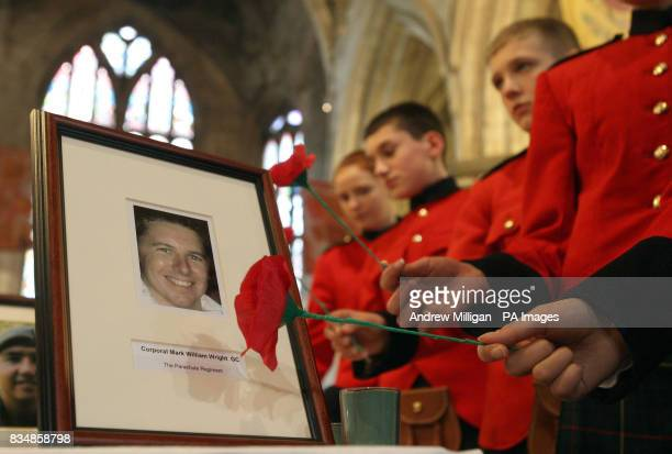 School children from the Queen Victoria School lay poppies beside photographs of soldiers killed in action including Corporal Mark Williams Wright...