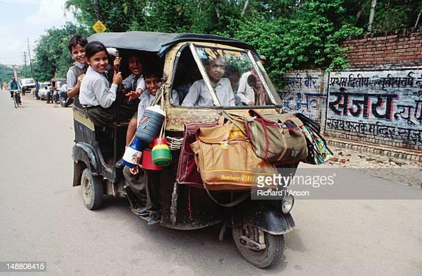 School children going home in auto rickshaw.