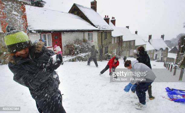 School children have a snowball fight on the iconic Gold Hill in Shaftesbury Dorset where it has snowed everyday this week
