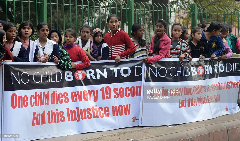 School children hold placards and banners as they march during the 'Nine is Mine', Public Day March in New Delhi on February 2, 2013. 'Nine is Mine' is a participatory children's initiative to ensure that the Central Government commits nine percent of the GDP on Health and Education as promised by the Congress-led UPA Government in their National Common Minimum Programme. AFP PHOTO/RAVEENDRAN
