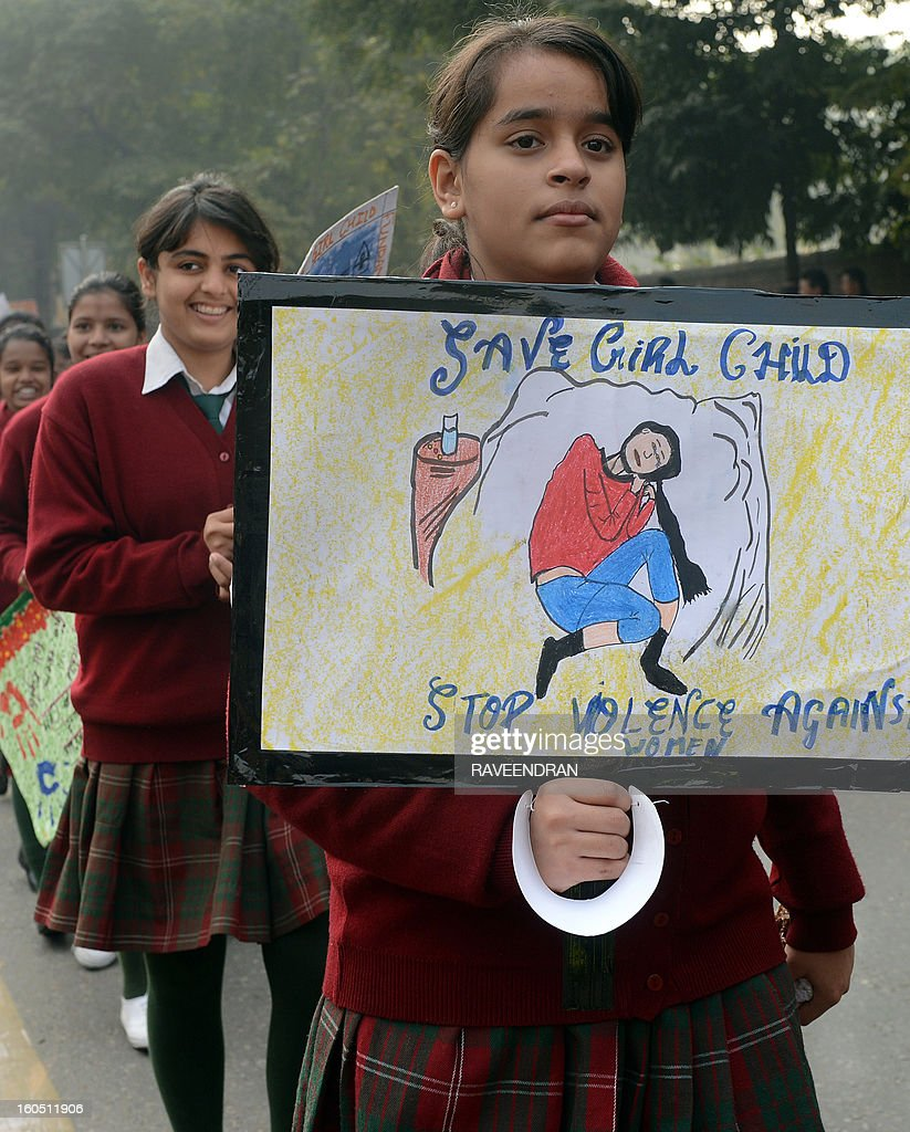 School children hold placards and banners as they march during the 'Nine is Mine', Public Day March in New Delhi on February 2, 2013. 'Nine is Mine' is a participatory children's initiative to ensure that the Central Government commits nine percent of the GDP on Health and Education as promised by the Congress-led UPA Government in their National Common Minimum Programme.