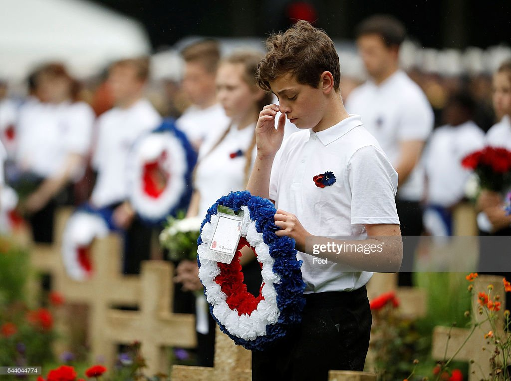 School children hold wreaths during the 100th anniversary of the beginning of the Battle of the Somme at the Thiepval memorial to the Missing on July 1, 2016 in Thiepval, France. The event is part of the Commemoration of the Centenary of the Battle of the Somme at the Commonwealth War Graves Commission Thiepval Memorial in Thiepval, France, where 70,000 British and Commonwealth soldiers with no known grave are commemorated.