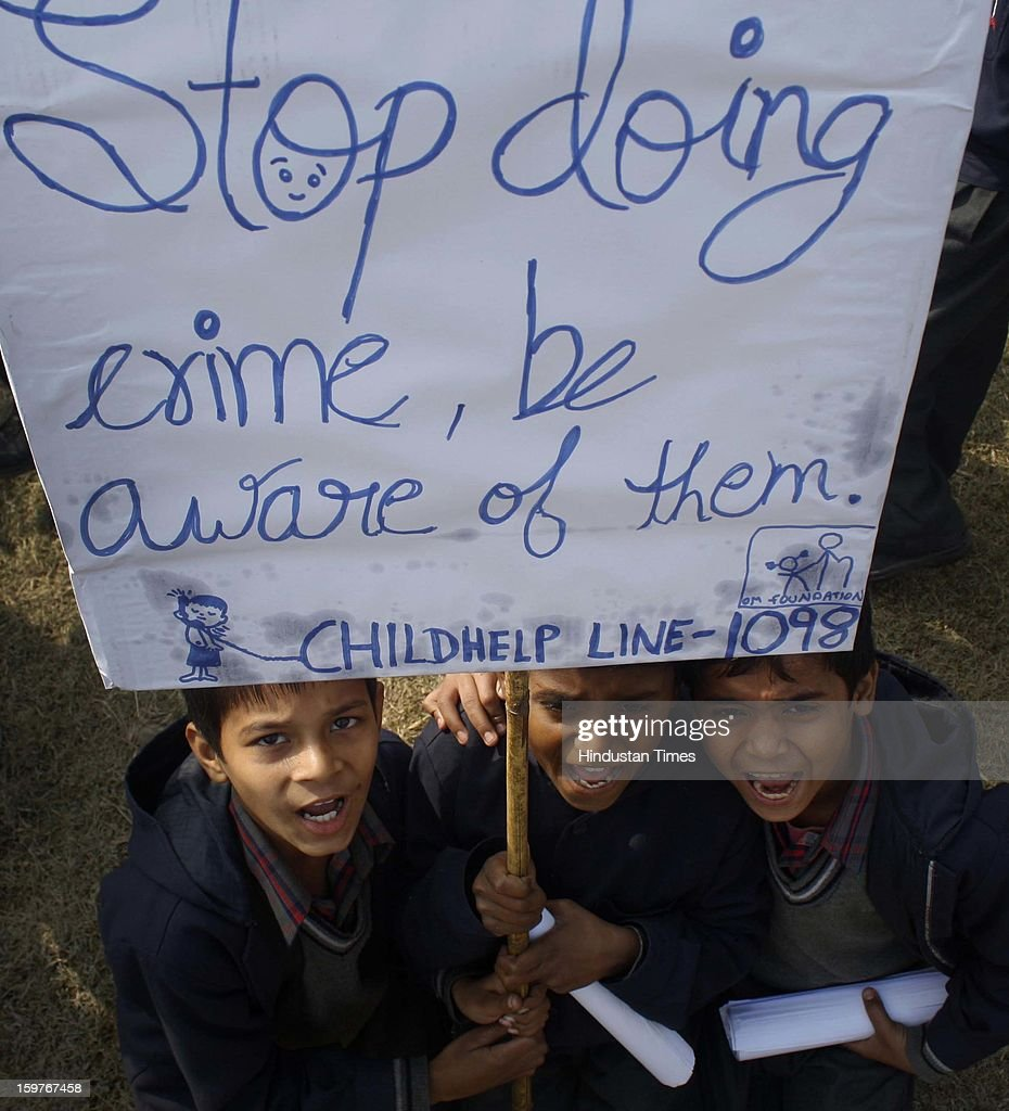 School children holding placard and shouting slogans during an awareness which was organised with support of Childline & other NGO's against the sexual violence against women & children at Hoshyarpur, Sector 51, on January 20, 2013 in Noida, India. Hundreds of school children participated in the Walkathon & marched through nearby areas with the theme Chupp Na Raho (Don't remain silent) Maa Se Kaho (Tell your mother).