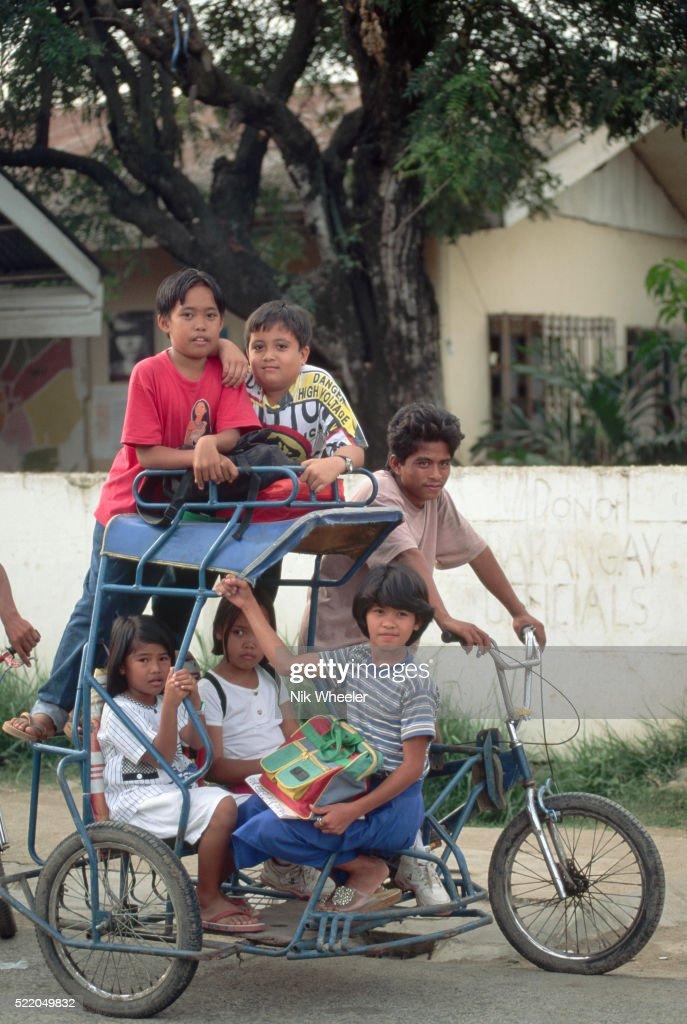 School Children in a Pedicab