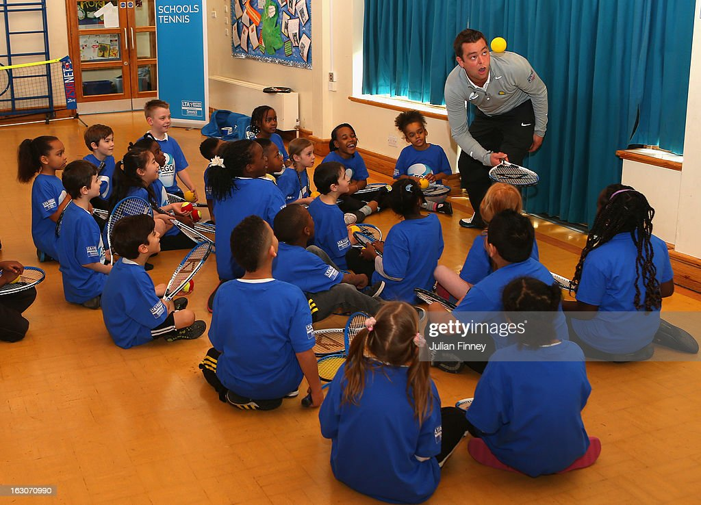 School children listen to a coach as they play tennis at Britannia Village Primary School on March 4, 2013 in London, England. Aegon Schools Tennis Programme names Britannia Village Primary School, Newham as the 15,000th School beneficiary today which coincides with World Tennis Day.