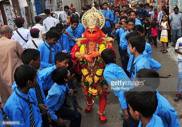 School children look at an artist dressed as monkey god Hanuman during a religious procession on the occasion of Hanuman Jayanti in Allahabad Hanuman...