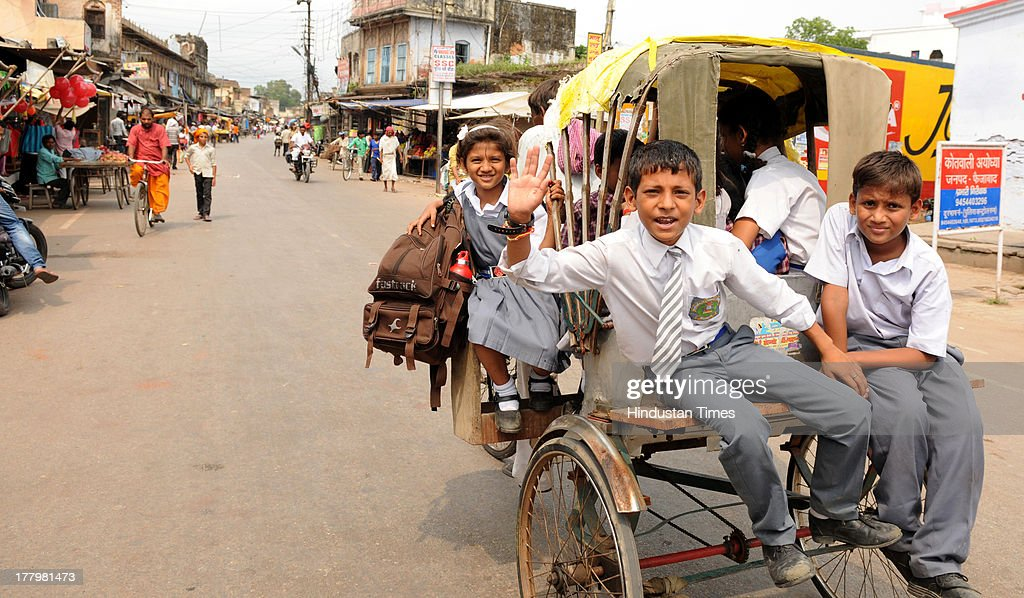 School children on rickshaw returning back from school as normalcy returned on August 26, 2013 in Ayodhya, India. High security was on alert in Ayodhya in wake of Vishwa Hindu Parishad's (VHP) 84 Kosi yatra, which was banned by Uttar Pradesh government.