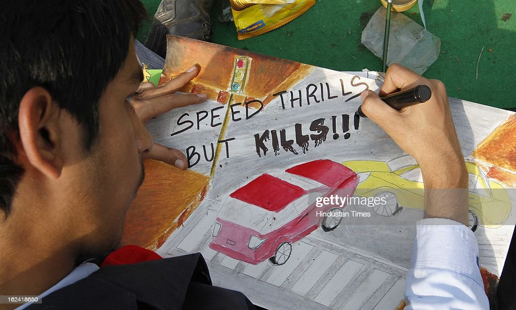 School children participated in painting competition on road safety during Delhi Police week at India Gate Lawn on February 22, 2013 in New Delhi, India.