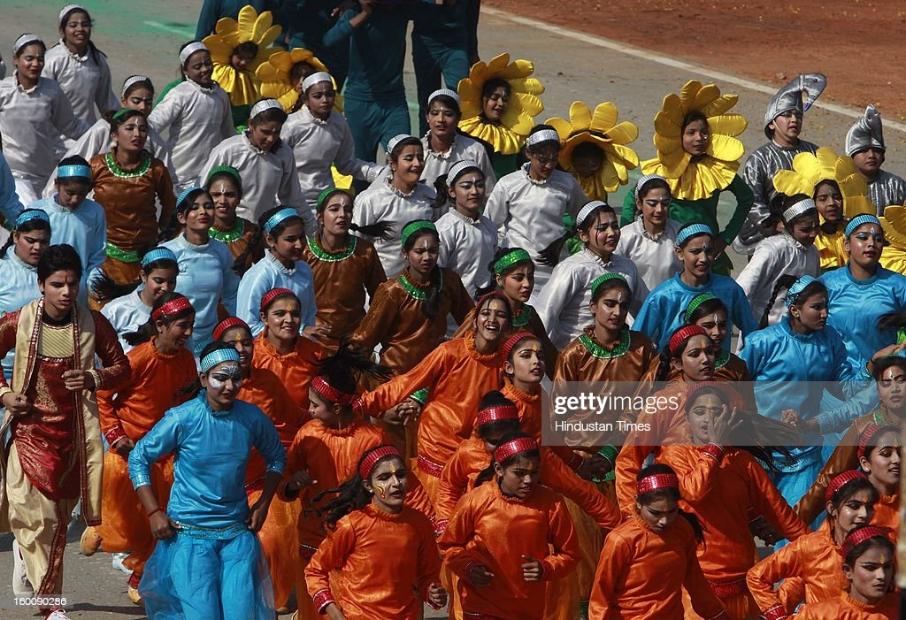 School children performing a dance during the 64th Republic Day parade celebration at Raj path on January 26, 2013 in New Delhi, India. India marked its Republic Day with celebrations held under heavy security, especially in New Delhi where large areas were sealed off for an annual parade of military hardware.