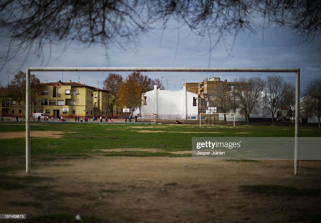 School children play excercise outside their school on November 30, 2012 in Villacanas, Spain. During the boom years, where in its peak Spain built some 800,000 houses a year accompanied by the manufacturing of millions of wooden doors, the people of Villacanas were part of Spain's middle class enjoying high wages and permanent jobs. During the construction boom years the majority of the doors used within these new developments were made in this small industrial town. Approximately seven million doors a year were once assembled here and the factory employed a workforce of almost 5700 people, but the town is now left almost desolate with the Villacanas industrial park now empty and redundant. With Spain in the grip of recession and the housing bubble burst, Villacanas is typical of many former buoyant industrial Spanish towns now struggling with huge unemployment problems.