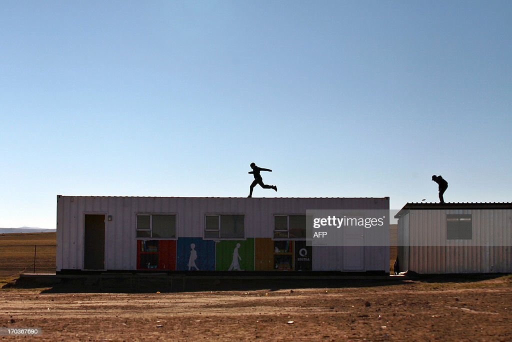 School children play on June 11, 2013 play on the roof of a building at the Nelson Mandela No-Moscow Primary School in Qunu, near Mthatha in the Eastern Cape, where former South African president Nelson Mandela grew up before returning to the village after his term as president. . In the rural South African village where he once roamed as a boy, the lowered flags at Nelson Mandela's homestead are a constant reminder of his absence. Ill health forced the 94-year-old, now battling a lung infection in hospital, to leave Qunu months ago, but his latest illness has sparked prayers, worry and resignation in his home town.