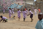 School children play on May 28 2014 in a dusty field in Mathare one of the poorest slums in Nairobi Running water and electricity are scarce and...