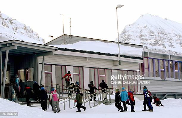 DESHAYES School children play outside at the Longyearbyen school located in the Svalbard archipelago and nestled snugly between a fjord and mountains...