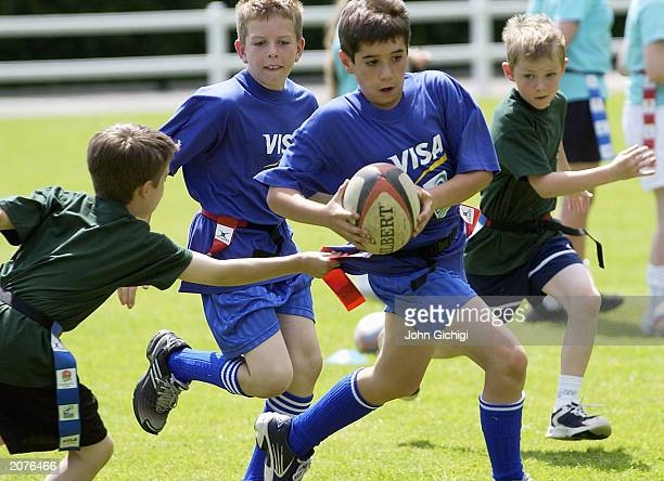 School children play tag rugby during a Visa Tag coaching clinic for local schools at the Henley RFC on June 12 2003 in Henley England
