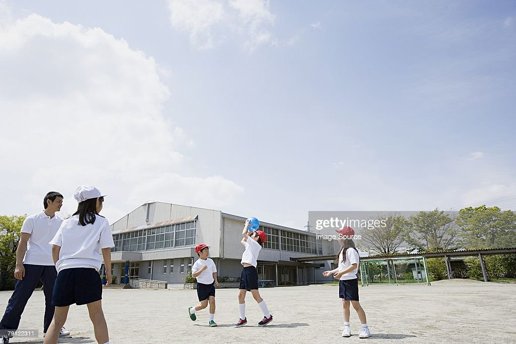 School children playing a ball game