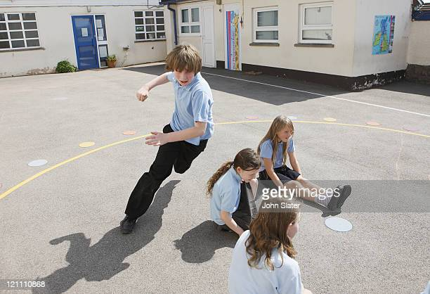 school children playing in playground