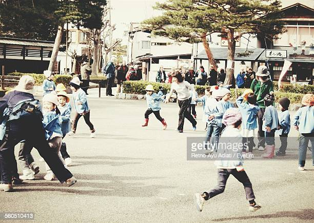School Children Running On Playground
