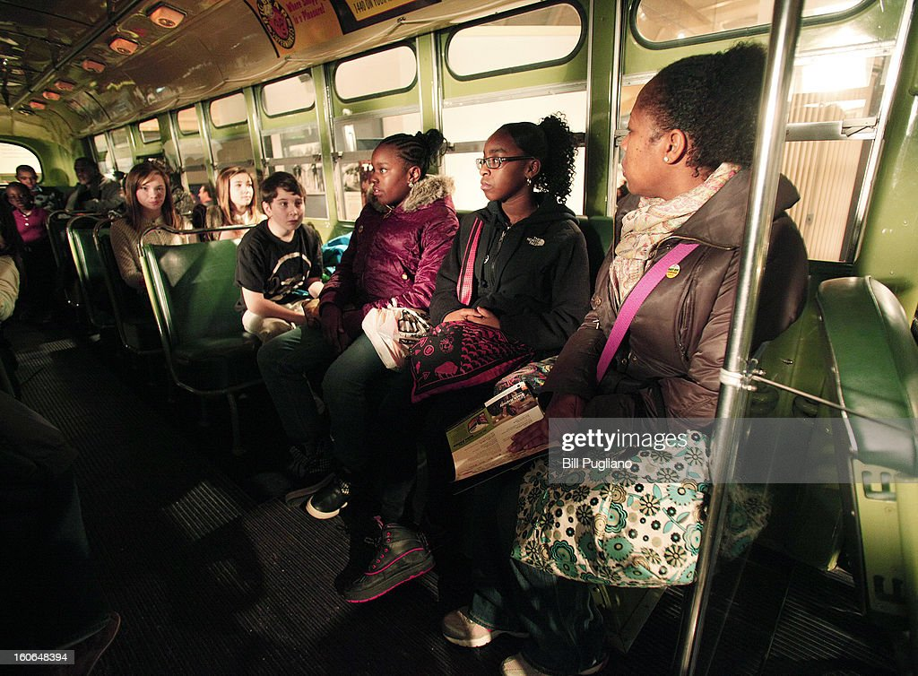 School children sit on the bus that civil rights icon Rosa Parks made famous when she refused to give up her seat February 4, 2013 at The Henry Ford in Dearborn, Michigan. U.S. Postal Service unvieled the Rosa Parks commemorative stamp January 4, on what would have been Park's 100th birthday.
