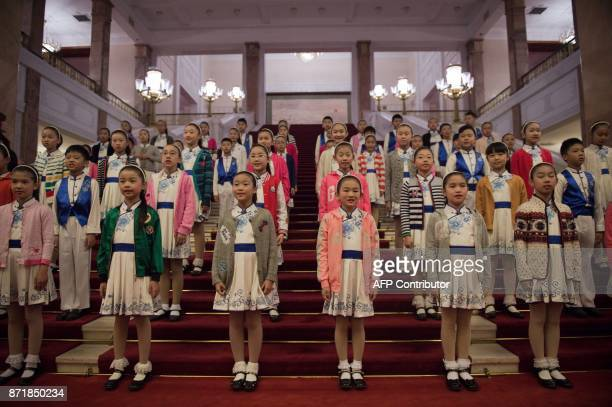 TOPSHOT School children stand on a staircase ahead of a welcome ceremony with US President Donald Trump and Chinese President Xi Jinping outside the...