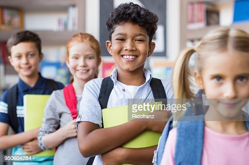 School children standing in a row : Stock Photo