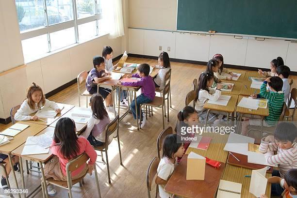 School children (5-11) studying in classroom