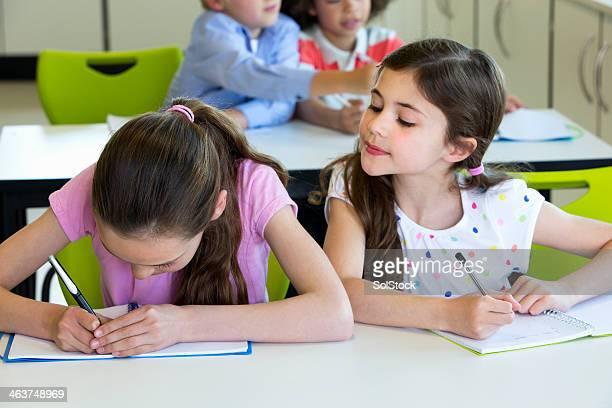 School Children taking Notes
