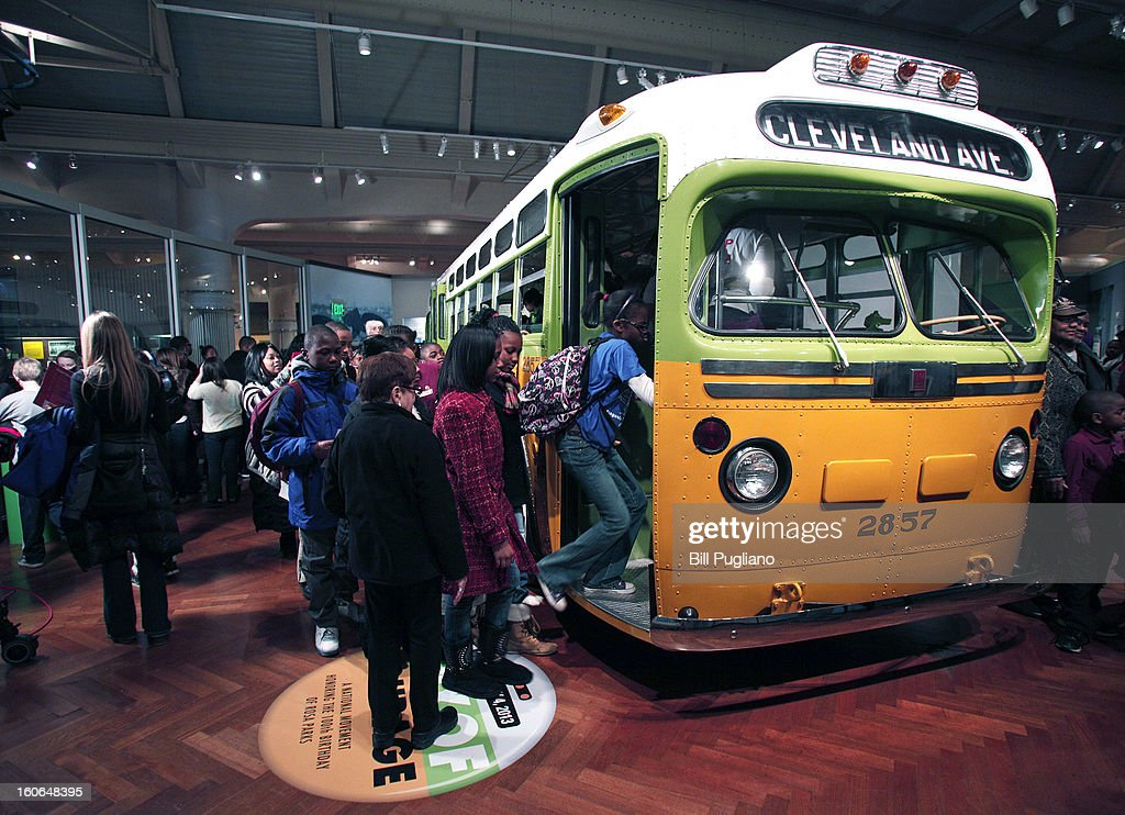 School children tour the bus that civil rights icon Rosa Parks made famous when she refused to give up her seat February 4, 2013 at The Henry Ford in Dearborn, Michigan. U.S. Postal Service unvieled the Rosa Parks commemorative stamp January 4, on what would have been Park's 100th birthday.