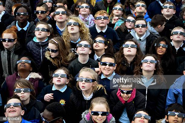 School children use special glasses to look into the sky at a partial solar eclipse on March 20 2015 in Glasgow Scotland Over Central Europe the moon...
