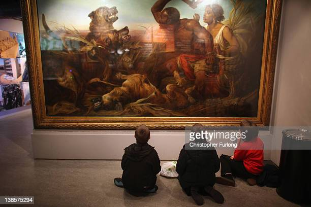 School children view a painting depicting slaves at the International Slavery Museum on February 9 2012 in Liverpool England The maritime city of...