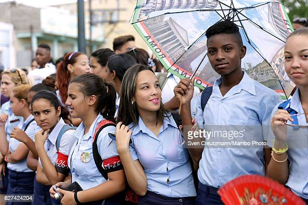 School children wait for the remains of former Cuban President Fidel Castro to pass by on their fourday journey across the country December 3 2016 in...