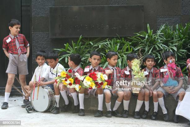 School children wait outside Sachin Tendulkar's house at Perry Crtoss Road bandra to meet him after he shifts on Wednesday