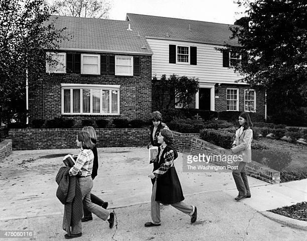 FILE School children walk past the house of President Ford in Alexandria VA on November 4 1976