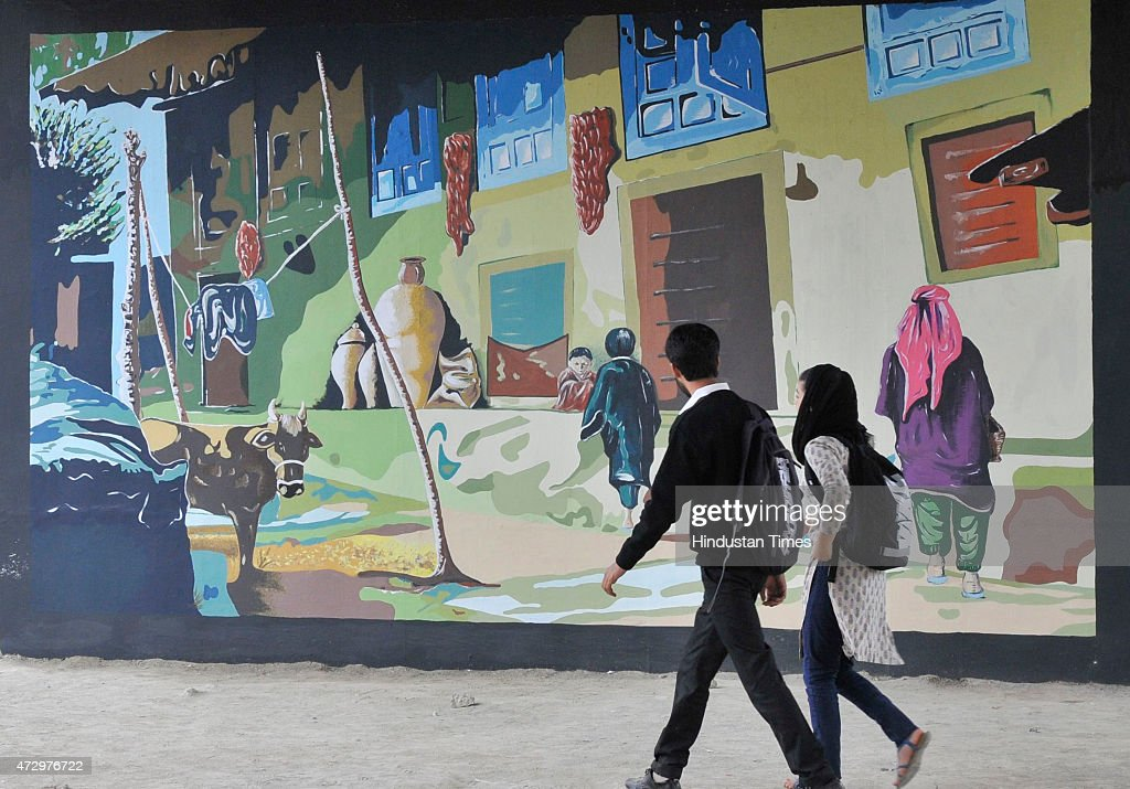 School Children Walk Past The Painting Murals On The City Walls Painted By  The Fine Arts Part 69