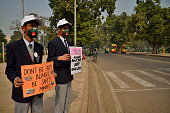 School children with hoarding at rajpath on the first day of odd even implementation on January 1 2016 in New Delhi India