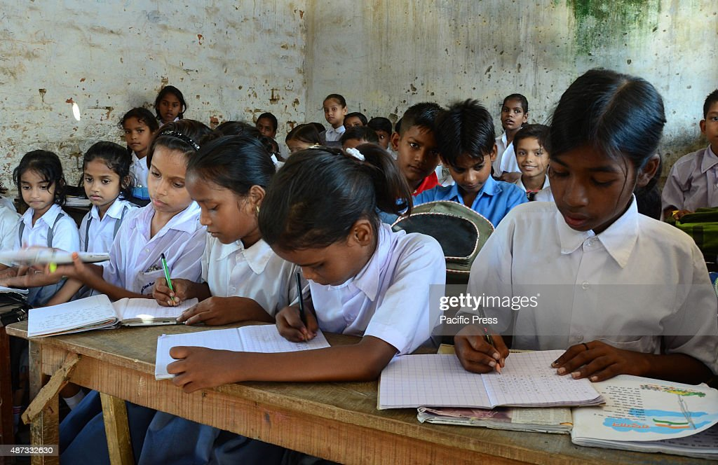 School children writing inside the classroom at a governmentrun school during International Literacy Day in Allahabad According to Indian Census 2011...