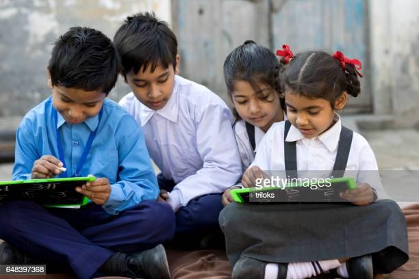 School children writing on slate