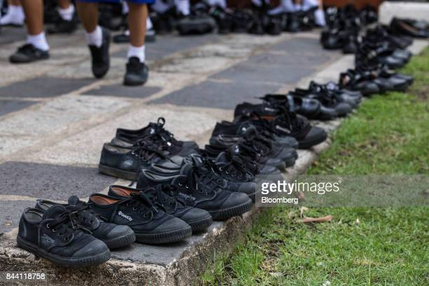 School children's shoes sit in the grounds of the Bangkok National Museum during preparations for the cremation ceremony of King Bhumibol Adulyadej...