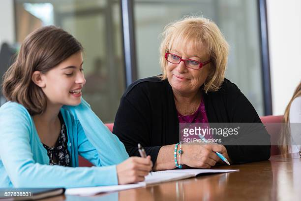 School counselor meeting with preteen student for evaluation
