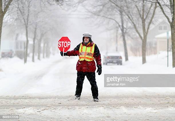 School crossing guard on a snowy Wisconsin street