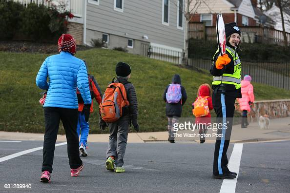School crossing guard Teresa Noonan helps Nottingham Elementary School students cross Little Falls Rd before school Noonan is using for the first...