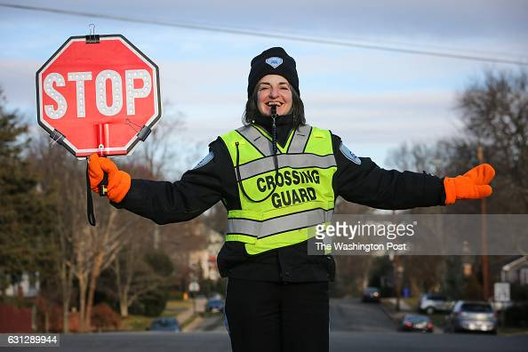 School crossing guard Teresa Noonan stands at the corner of Little Falls Rd and John Marshall Dr to assist Nottingham Elementary School students...