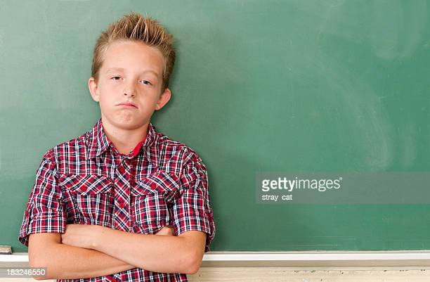 School Days: Bored Kid at Chalkboard with Copyspace