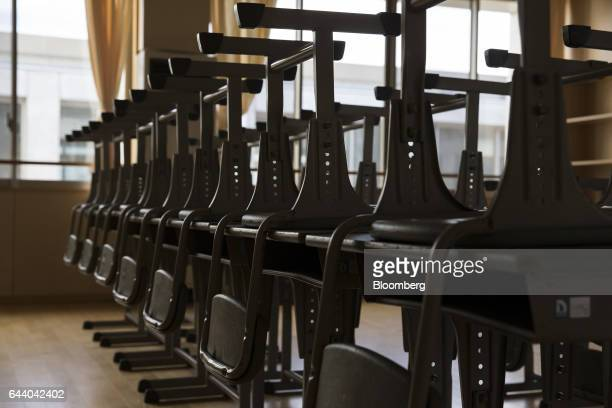School desks and chairs sit in a classroom at the Narahamachi elementary school during preparations for the school's reopening in April in Naraha...