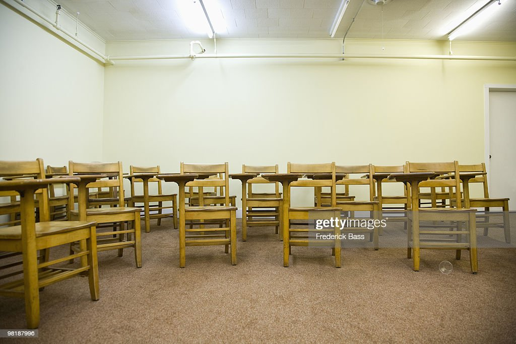 School Desks In An Empty Classroom Stock Photo | Getty Images