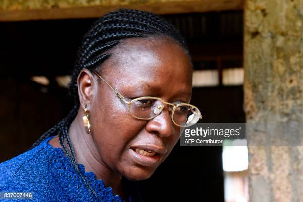 School director AnnMarie Caulker weeps during an interview in Freetown on August 18 2017 A week after Sierra Leone's capital was struck by flooding...