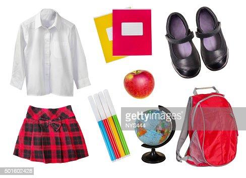 School female uniform & supplies isolated on white. : Stock Photo
