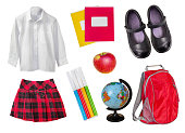 School female uniform isolated. Child's education supplies.Girl's study objects & accessories on white background.