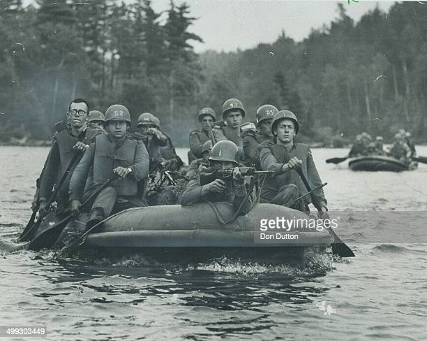 School for war in Ontario's north woods includes capture of a dam by officer candidates who paddle in to attach on inflated rubber boat Exercise...
